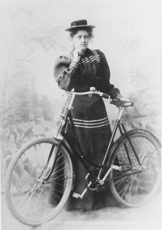 Mia Green with her bicycle, circa 1900. Likely a self-portrait. Image source: Haparanda stads bildarkiv